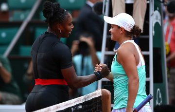 RESPECT: Serena Williams and Ash Barty share a moment at the net after their French Open second round battle; Getty Images