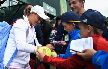 NOTTINGHAM, ENGLAND - JUNE 17:  Ashleigh Barty of Australia leaves the court and signs autographs for fans after the Womens Singles Final during Day Nine of the Nature Valley Open at Nottingham Tennis Centre on June 17, 2018 in Nottingham, United Kingdom.  (Photo by Ben Hoskins/Getty Images for LTA)