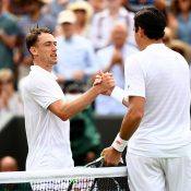 John Millman (L) shakes hands with Milos Raonic after losing their second-round match at Wimbledon; Getty Images