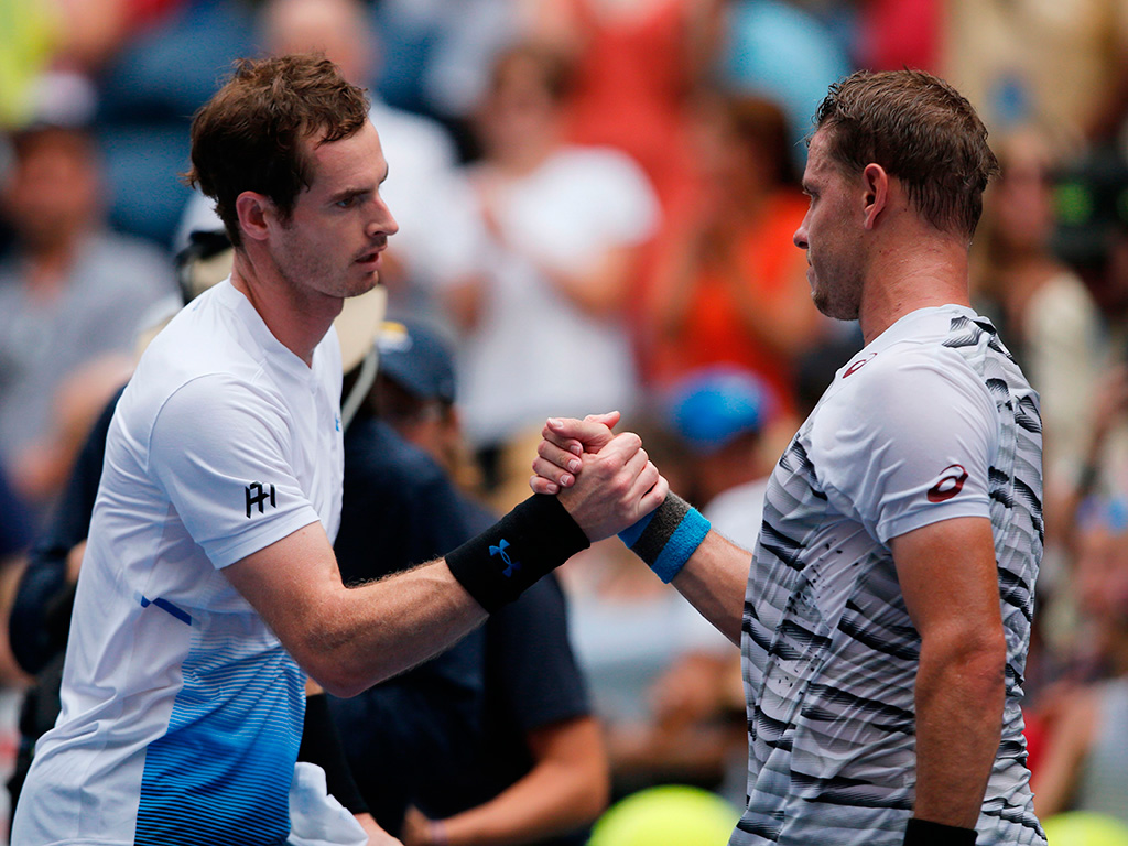 Andy Murray (L) and James Duckworth shake hands after their US Open first-round match; Getty Images