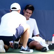 Jason Kubler receives is attended to by a physio after rolling his ankle during the third set of his second-round loss to Taylor Fritz at the US Open; Getty Images