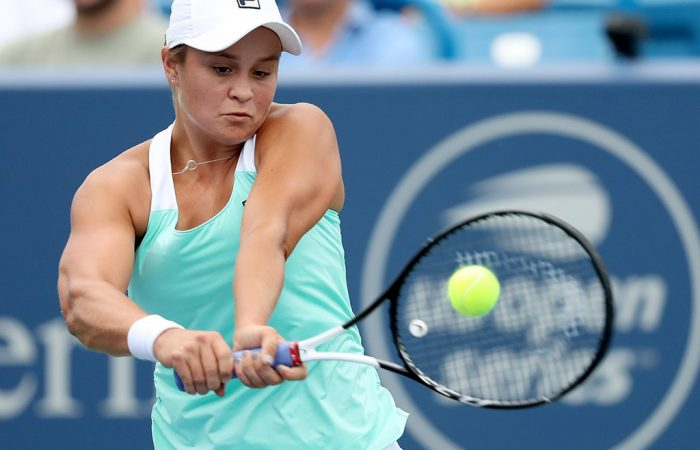 MASON, OH - AUGUST 17:  Ashleigh Barty of Australia returns a shot to Simona Halep of Romania during the Western & Southern Open at Lindner Family Tennis Center on August 17, 2018 in Mason, Ohio.  (Photo by Matthew Stockman/Getty Images)