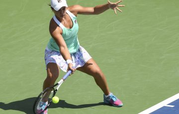 MONTREAL, QC - AUGUST 09:  Ashleigh Barty of Australia hits a return against Alize Cornet of France during day four of the Rogers Cup at IGA Stadium on August 9, 2018 in Montreal, Quebec, Canada.  (Photo by Minas Panagiotakis/Getty Images)