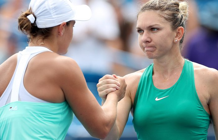 MASON, OH - AUGUST 17:  Ashleigh Barty of Australia congratulates Simona Halep of Romania during the Western & Southern Open at Lindner Family Tennis Center on August 17, 2018 in Mason, Ohio.  (Photo by Matthew Stockman/Getty Images)