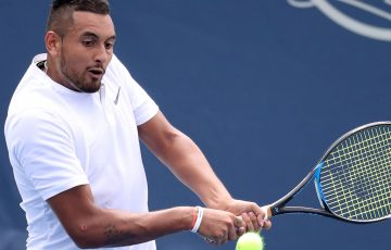 MASON, OH - AUGUST 17: Nick Kyrgios of Australia returns a shot to Juan Martin Del Potro of Argentina during Day 7 of the Western and Southern Open at the Lindner Family Tennis Center on August 17, 2018 in Mason, Ohio. (Photo by Rob Carr/Getty Images)