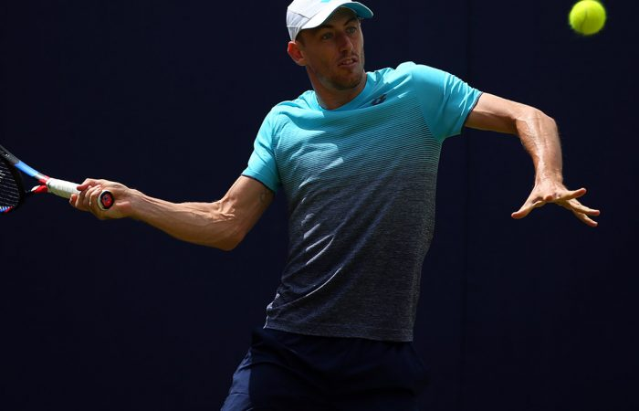 LONDON, ENGLAND - JUNE 17: John Millman of Australia hits a forehand during his match against Marius Copil of Romania during qualifying Day 2 of the Fever-Tree Championships at Queens Club on June 17, 2018 in London, United Kingdom. (Photo by Marc Atkins/Getty Images)