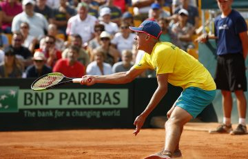 Alex De Minaur in action during his Davis Cup reverse singles rubber against Dominic Thiem in Australia's World Group Play-off tie against Austria in Graz; Getty Images