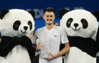 Bernard Tomic of Australia celebrates after winning the men's singles final against Fabio Fognini of Italy at the ATP Chengdu Open tennis tournament in Chengdu, in China's southwest Sichuan province on September 30, 2018. (Photo by STR / AFP) / China OUT (Photo credit should read STR/AFP/Getty Images)