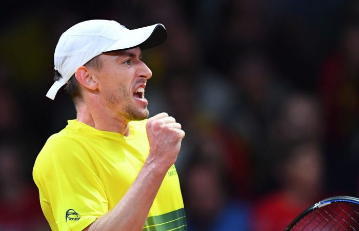 Australia's John Millman reacts after a returning a ball to Belgium's David Goffin during the Davis Cup tennis semifinal match between Belgium and Australia in Brussels on September 15, 2017.   / AFP PHOTO / EMMANUEL DUNAND        (Photo credit should read EMMANUEL DUNAND/AFP/Getty Images)