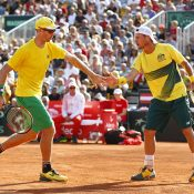 John Peers (L) and Lleyton Hewitt in doubles action against Oliver Marach and Jurgen Melzer in Australia's Davis Cup World Group Play-off tie against Austria in Graz; Getty Images