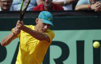 Australia's Alex De Minaur returns the ball to Austria's Dennis Novak during their Davis Cup Playoff tennis match between Austria and Australia on September 14, 2018 in Graz, Austria. (Photo by ERWIN SCHERIAU / APA / AFP) / Austria OUT (Photo credit should read ERWIN SCHERIAU/AFP/Getty Images)