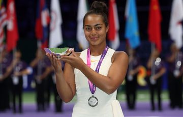 Annerly Poulos poses with her trophy after finishing runner-up in the U16 WTA Future Stars event in Singapore; Getty Images