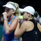 Ashleigh Barty (R) and CoCo Vandeweghe discuss tactics during their WTA FInals semifinal loss to Timea Babos and Kristina Mladenovic; Getty Images