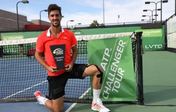Thanasi Kokkinakis poses with the trophy after winning the Las Vegas Tennis Open (photo credit: ATP Challenger Tour)