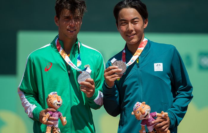 Silver Medalists Adrian Andreev BUL (left) and Rinky Hijikata AUS - playing as a Mixed International Team - pose for a photograph with their medals during the victory ceremony for the Tennis Men's Doubles at the Buenos Aires Lawn Tennis Club, Green Park. The Youth Olympic Games, Buenos Aires, Argentina Sunday 14th October 2018. Photo: Florian Eisele for OIS/IOC. Handout image supplied by OIS/IOC