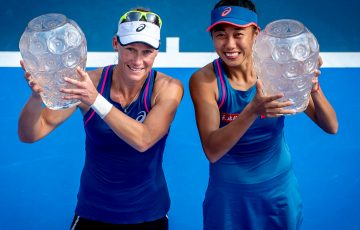 Sam Stosur (L) and Zhang Shuai pose with their trophies after winning the WTA doubles title in Hong Kong (credit: Prudential Hong Kong Tennis Open)