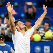 Bernard Tomic celebrates his victory at the ATP tournament in Chengdu, China; Getty Images