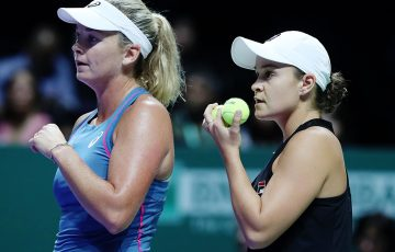 SINGAPORE - OCTOBER 26:  CoCo Vandeweghe of the United States and Ashleigh Barty of Australia discuss a play against Elise Mertens of Belgium and Demi Schuurs of the Netherlands in the Women's Doubles Quarterfinal Match on Day 6 of the BNP Paribas WTA Finals Singapore presented by SC Global at Singapore Sports Hub on October 26, 2018 in Singapore.  (Photo by Matthew Stockman/Getty Images)