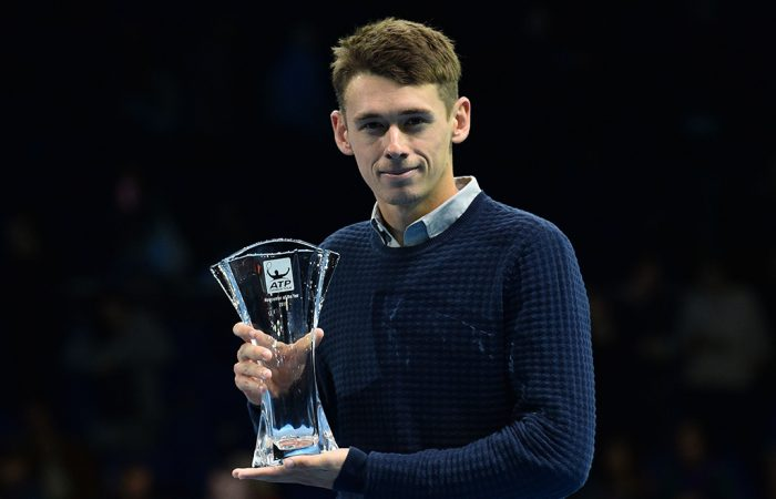 Alex De Minaur poses with his ATP Newcomer of the Year award on court at the ATP Finals in London; Getty Images