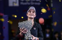 Ash Barty poses with the champion's trophy after winning the WTA Elite Trophy tournament in Zhuhai, China; Getty Images