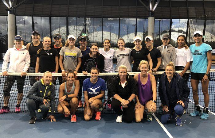 Casey Dellacqua (centre) joins several of Ausralia's top female tennis players at the Tennis Australia's WTA skills development camp in Melbourne.