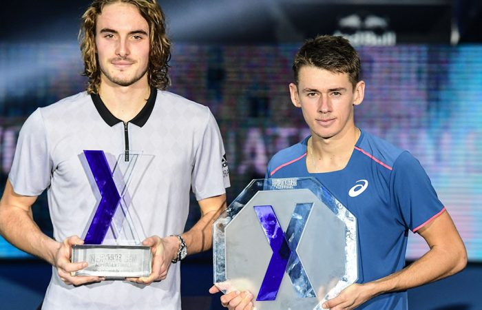 Winner Greece's Stefanos Tsitsipas (L) and runner-up Australia's Alex De Minaur pose with their trophy after the men's final of the Next Generation ATP Finals in Milan on November 10, 2018. (Photo by Miguel MEDINA / AFP)        (Photo credit should read MIGUEL MEDINA/AFP/Getty Images)