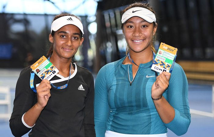 Naiktha Bains (L) and Destanee Aiava pose with their Australian Open player accreditations after winning the doubles final at the AO Play-off (photo: Elizabeth Xue Bai)