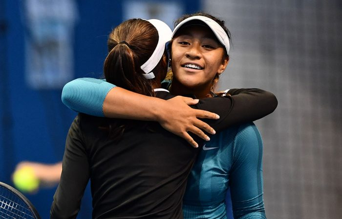 Destanee Aiava (R) hugs Naiktha Bains after the pair won the AO play-off doubles final (photo: Elizabeth Xue Bai)