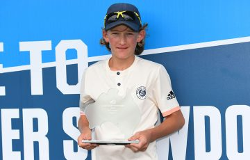 Charlie Camus poses with his trophy after winning the 12/u Australian singles title (photo: Elizabeth Xue Bai)