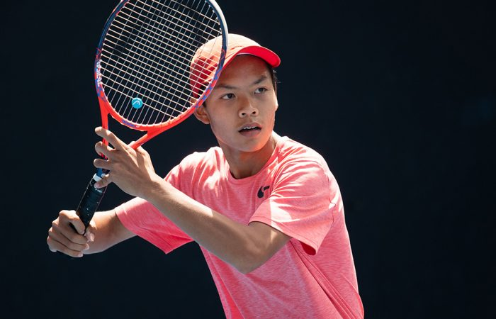 Derek Pham in action during the 14/u Australian Championships semifinals at Melbourne Park (photo: Elizabeth Xue Bai)