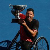 Dylan Alcott hoists the Australian Open 2018 champion's trophy; Getty Images