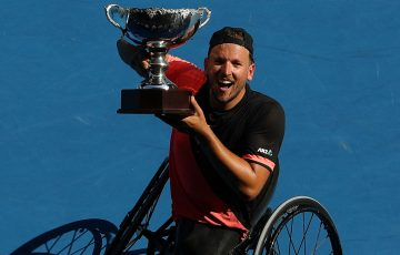 Dylan Alcott hoists the Australian Open 2018 champion's trophy; Getty Images