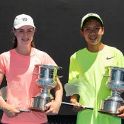 Talia Gibson (L) and Derek Pham pose with their trophies after winning the 14/u Australian titles at Melbourne Park (photo: Elizabeth Xue Bai)