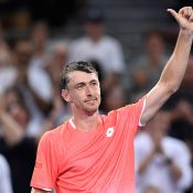 John Millman celebrates his first-round victory over Tennys Sandgren at the Brisbane International (Getty Images)