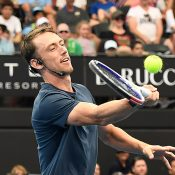 John Millman takes part in Kids Tennis Day at the Brisbane International (Getty Images)