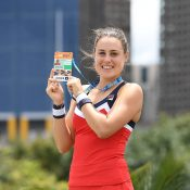 Kimberly Birrell poses with her Australian Open player credential after winning the AO Play-off final over Astra Sharma at Melbourne Park (photo: Elizabeth Xue Bai)