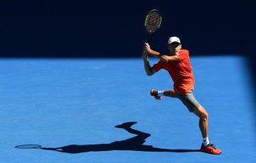 Home charge Alex de Minaur strikes a backhand during his opening round.
