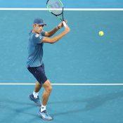 Alex De Minaur advances on the net at the Brisbane International (Getty Images)