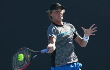 MELBOURNE, AUSTRALIA - JANUARY 09: Max Purcell of Australia hits a forehand in his match against Ricardas Berankis of Lithuania during day two of Qualifying for the 2019 Australian Open at Melbourne Park on January 9, 2019 in Melbourne, Australia.  (Photo by Mike Owen/Getty Images)
