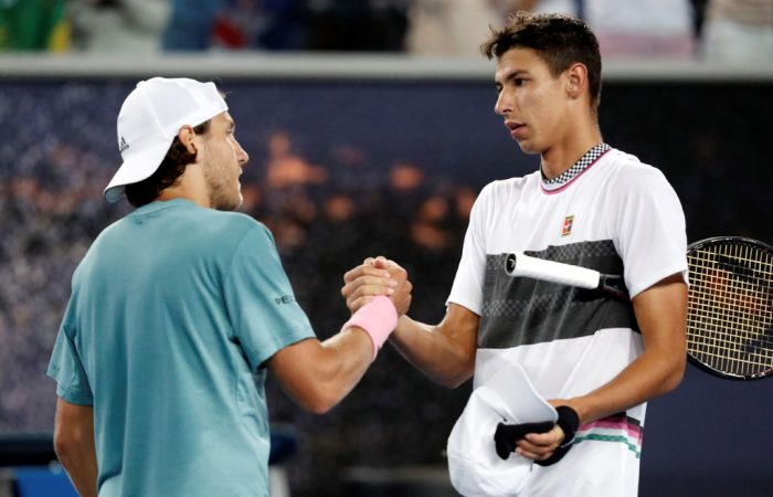 Lucas Pouille shakes hands with Australian wildcard Alexei Popyrin after their five-set battle on MCA.