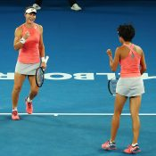 Sam Stosur (L) and Zhang Shuai in action during the Australian Open doubles semifinals at Rod Laver Arena (Getty Images)