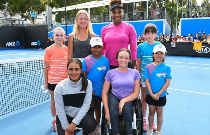 Amber Marshall (back row, left of Serena Williams) and Annerly Poulos (front left) at Australian Open 2019.