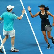John-Patrick Smith (L) and Astra Sharma in action in the Australian Open mixed doubles semifinals (Getty Images)