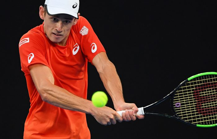 MELBOURNE, AUSTRALIA - JANUARY 18:  Alex De Minaur of Australia plays a backhand in his third round match against Rafael Nadal of Spain during day five of the 2019 Australian Open at Melbourne Park on January 18, 2019 in Melbourne, Australia.  (Photo by Quinn Rooney/Getty Images)