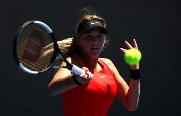 MELBOURNE, AUSTRALIA - JANUARY 19:  Amber Marshall of Australia plays a forehand in her first round Junior Girls' Singles match against Mana Kawamura of Japan during day six of the 2019 Australian Open at Melbourne Park on January 19, 2019 in Melbourne, Australia.  (Photo by Mike Owen/Getty Images)