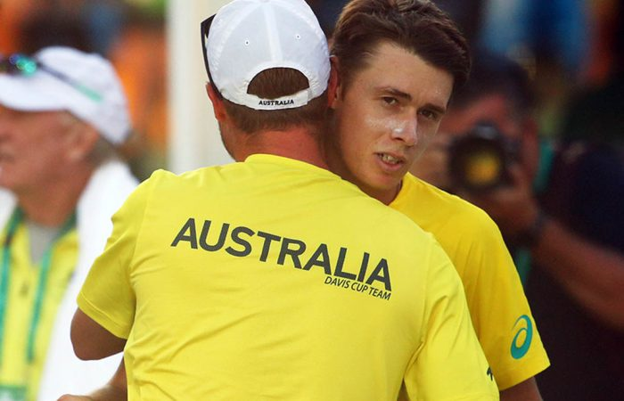 ADELAIDE, AUSTRALIA - FEBRUARY 01: Australia captain Lleyton Hewitt congratulates Alex de Minaur of Australia after he won his rubber 2 singles match against Mirza Basic of Bosnia / Herzegovina during the Davis Cup Qualifiers between Australia vs Bosnia and Herzegovina at Memorial Drive, Adelaide on February 01, 2019 in Adelaide, Australia. (Photo by Scott Barbour/Getty Images)