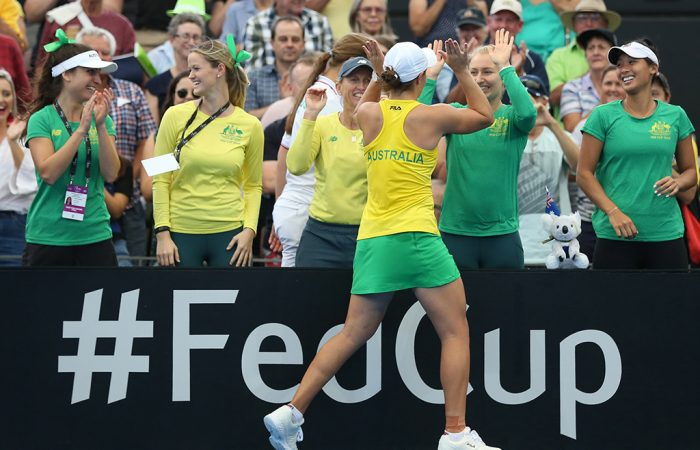 Ash Barty celebrates with the Australian bench after winning her reverse singles rubber against Aryna Sabalenka in Brisbane (Getty Images)