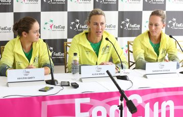 Australian Fed Cup captain Alicia Molik flanked by singles players and doubles duo Ash Barty (L) and Sam Stosur (R); Getty Images