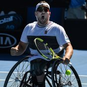 High Five: Dylan Alcott en route to a fifth straight Australian Open quad singles title; Getty Images