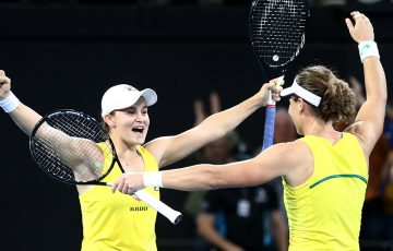 Ash Barty (L) and Sam Stosur celebrate Australia's doubles victory at Pat Rafter Arena (Getty Images)